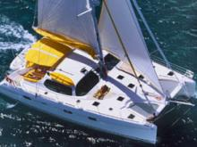 A crewed multi hull sailing yacht offers comfort and speed